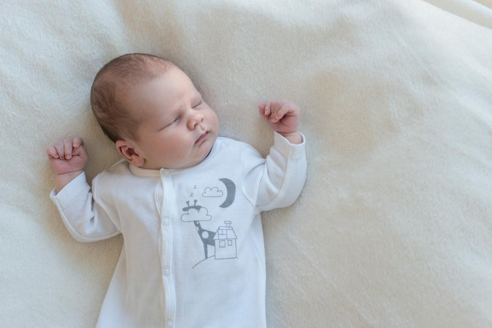 Младенец с кривошеей